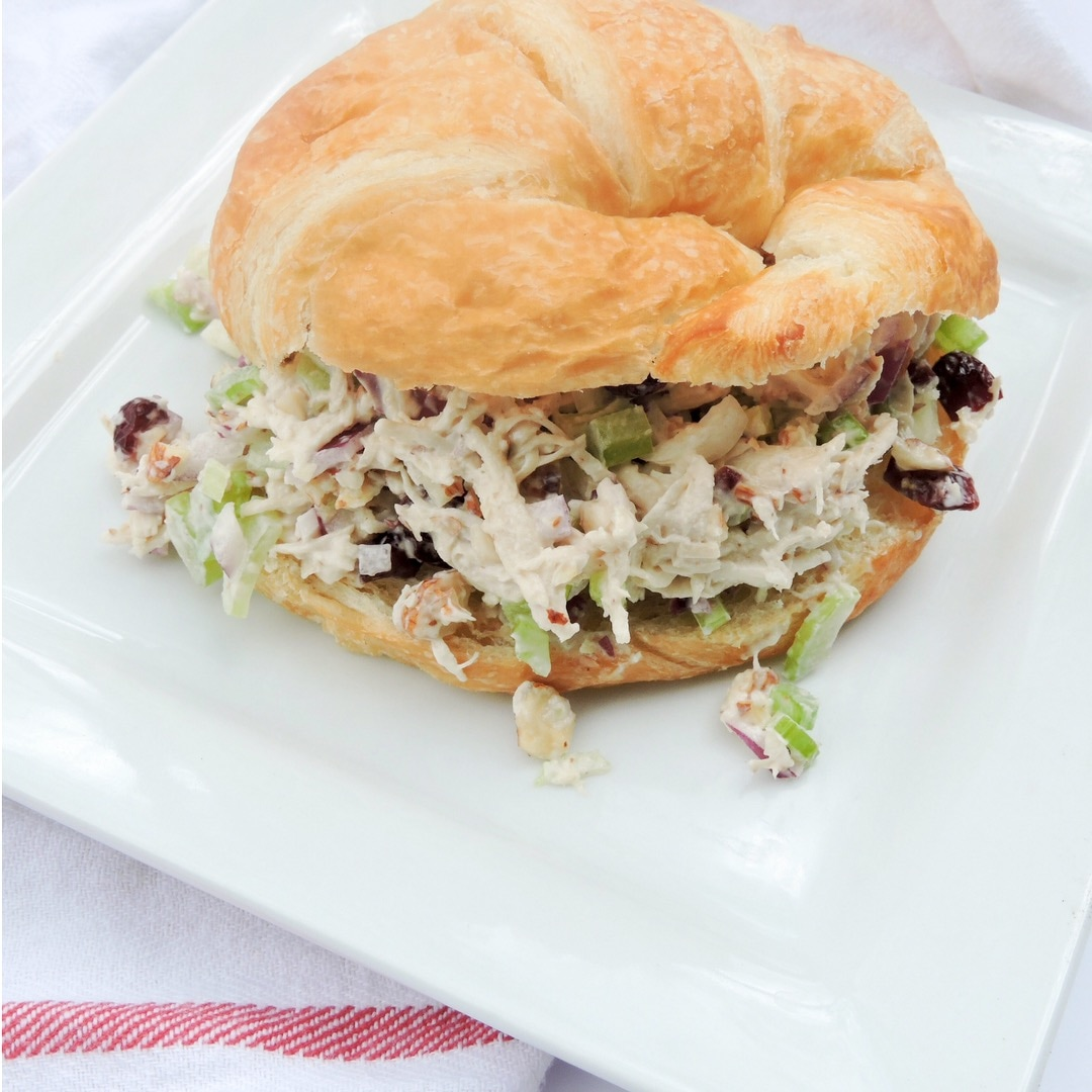 Chicken salad on a croissant sandwich with dried cranberries and almonds. The only chicken salad recipe you'll ever need.
