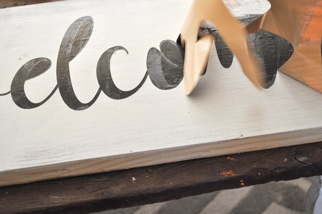 Easiest way to remove a stencil after painting