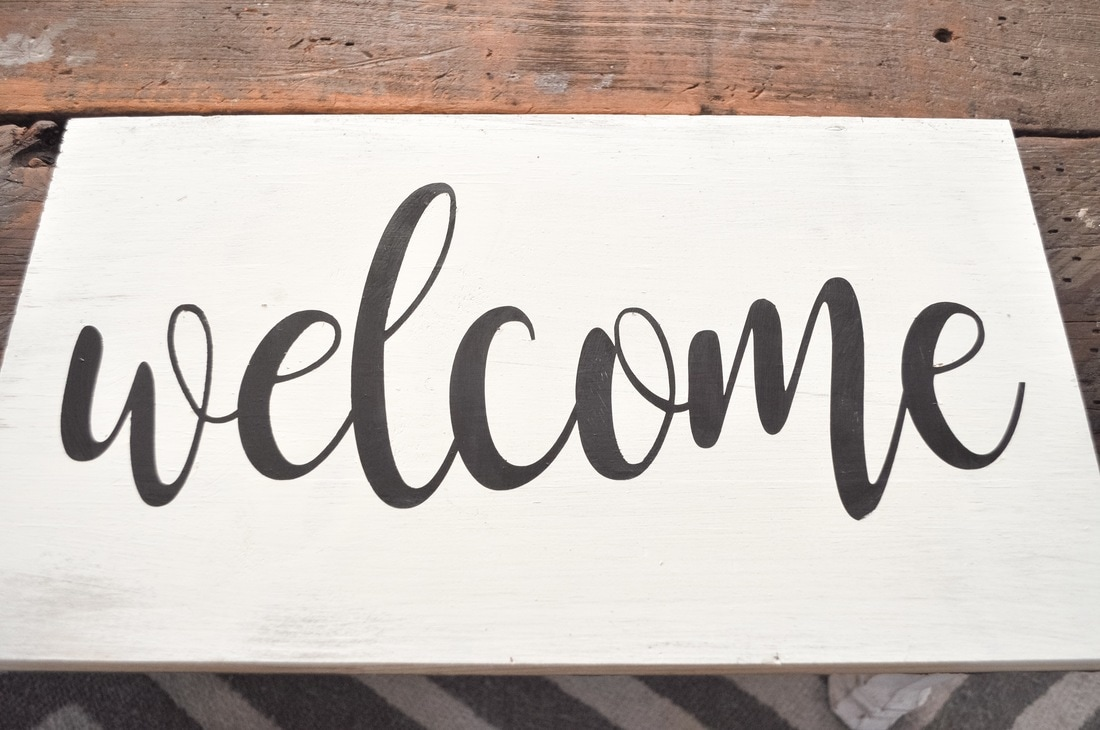 Cursive Welcome sign for entryway
