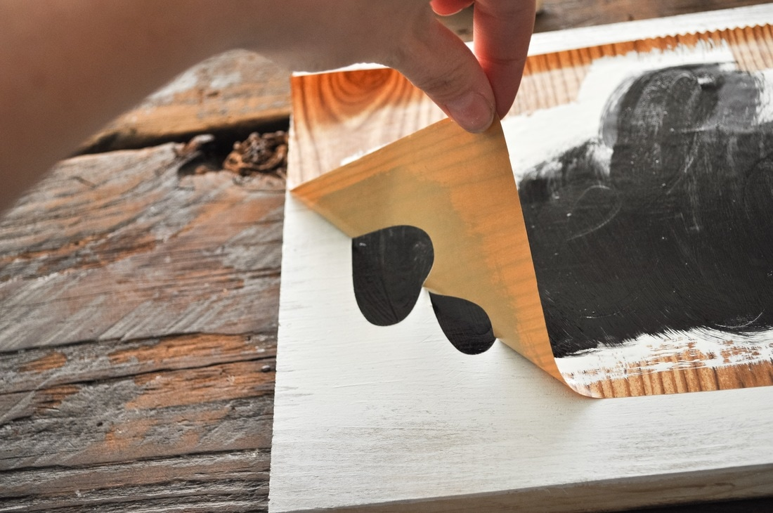 How do you apply a stencil to wood?