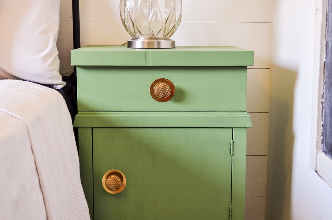 Vinyl accents behind knobs on a dresser makeover