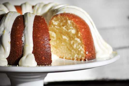 Dense and moist lemon bundt cake topped with a fresh squeezed lemon cream cheese frosting.