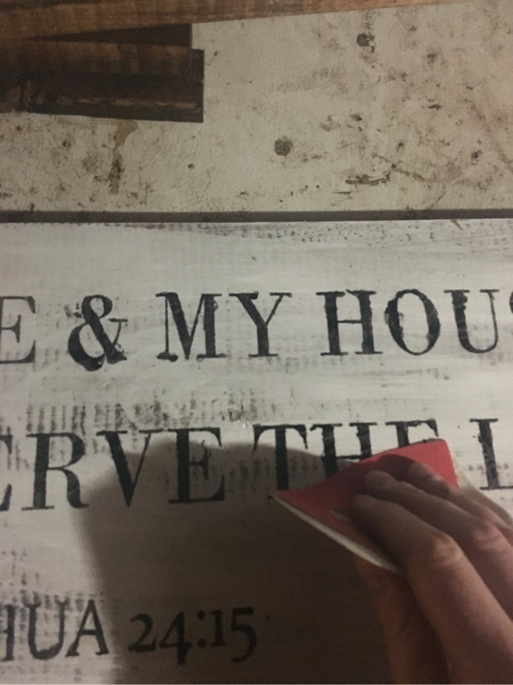Distressing a sign to make it look older and aged