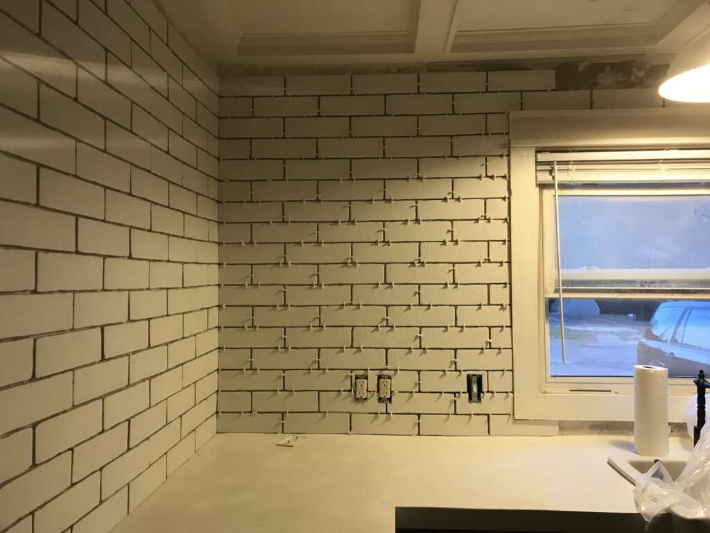 White faux brick tile backsplash for my old kitchen. Has the perfect old-world look, yet still new and fresh. The perfect porcelain tile backsplash.