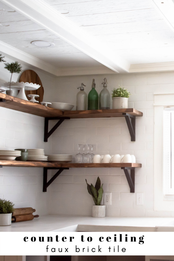 counter to ceiling white tile with wood open shelving. How to style open shelving.
