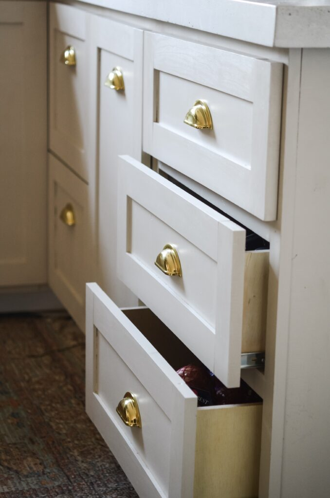 mushroom cabinets with brass hardware