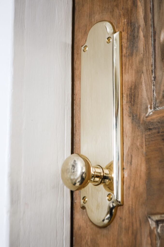 Brass doorknobs with tall rose