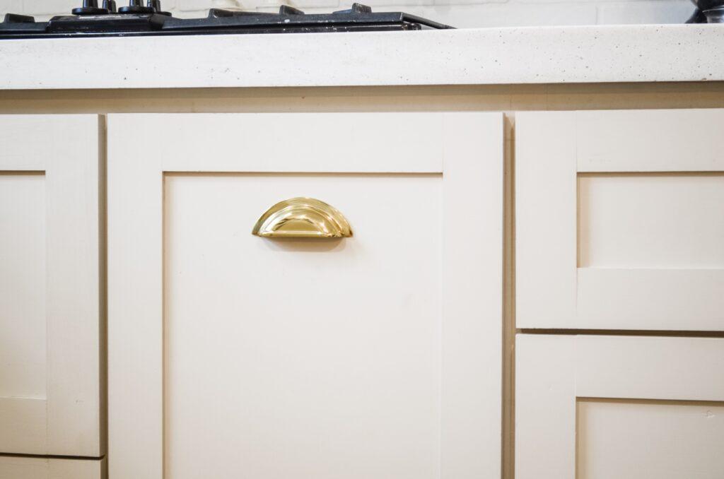 Beautiful brass cabinet pulls on mushroom cabinets