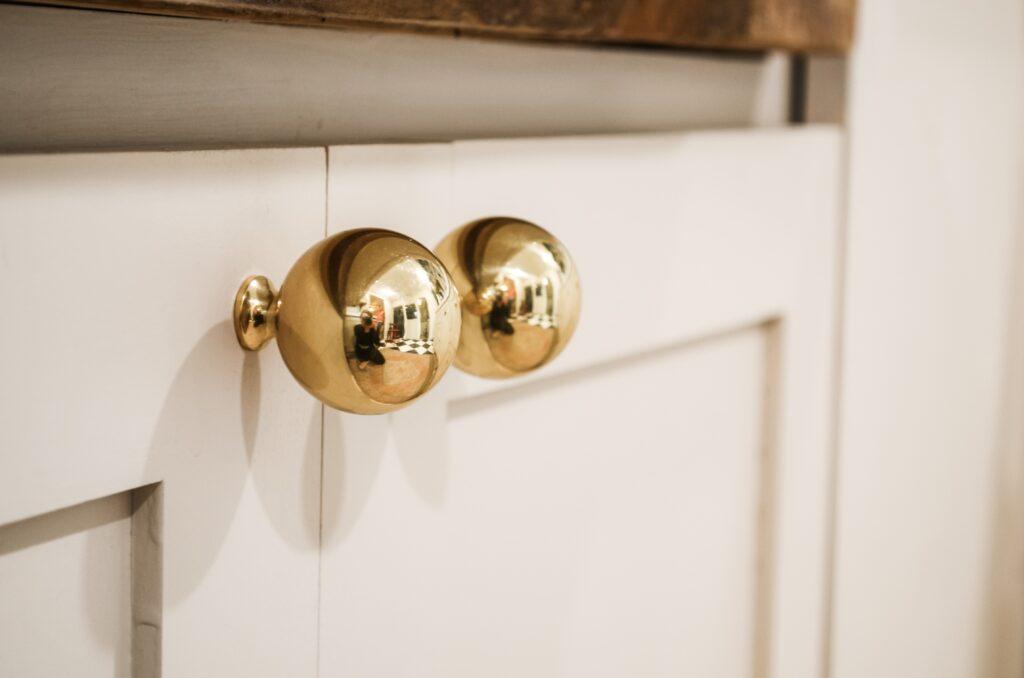 brass and mushroom cabinet combo