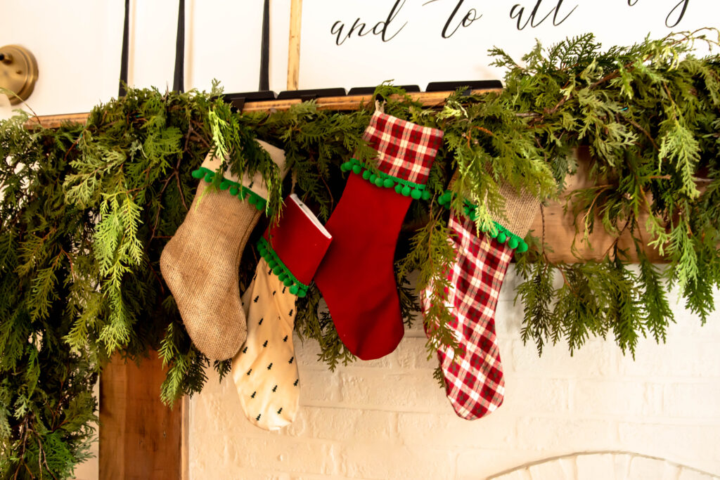 Christmas stockings in varying colors. Red, green, and burlap Christmas stockings.