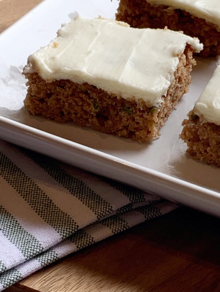 The most moist Zucchini Cake packed with Fall flavor!