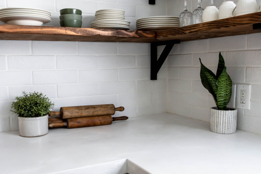 Charming White Concrete Countertops. Be sure to seal to maintain their beauty! #DIY #concrete