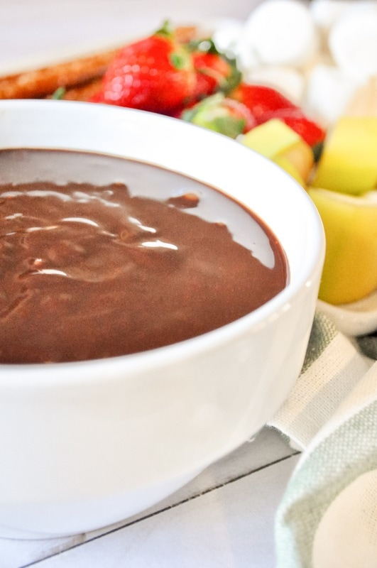 Impress your coming with this easy to make and oh so delicious chocolate fondue! #chocolate #newyears #christmas #valentinesday
