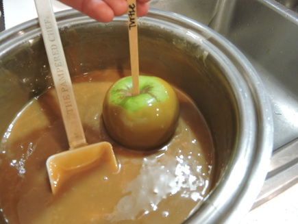 How to properly dip a caramel apple.